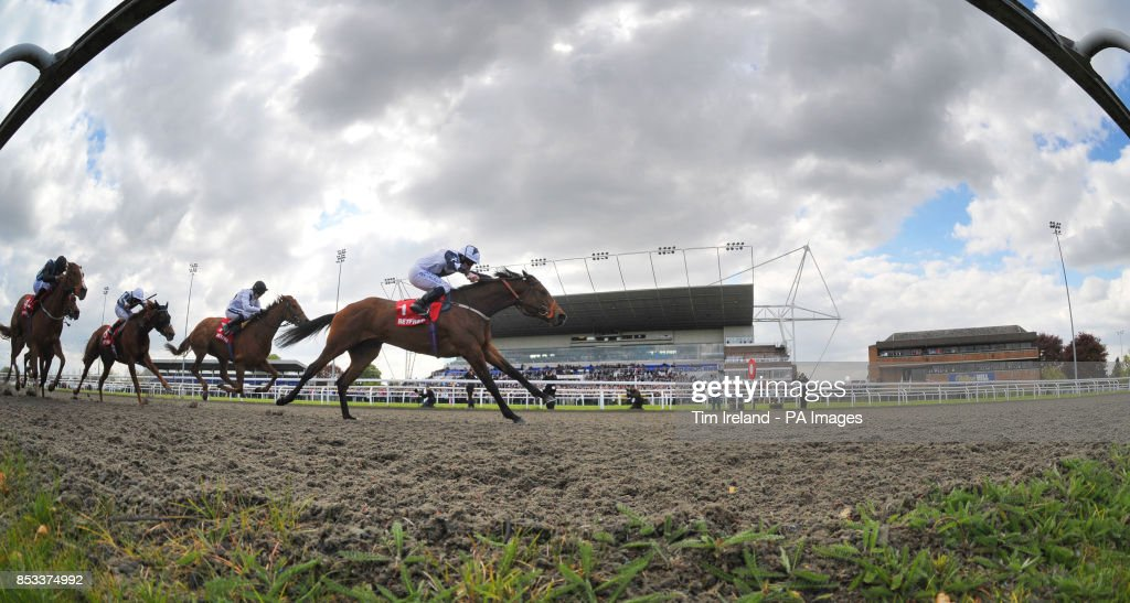 Horse racing easter family fun day kempton park racecourse zurigha ridden by ryan moore wins the betfred mobile lotto snowdrop fillies stakes during the negle Gallery