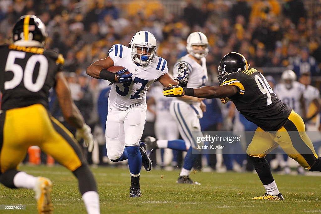 Zurlon Tipton #37 of the Indianapolis Colts runs the ball past Lawrence Timmons #94 of the Pittsburgh Steelers in the second half of the game at Heinz Field on December 6, 2015 in Pittsburgh, Pennsylvania.