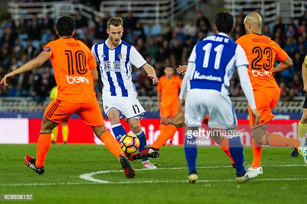 Zurutuza of Real Sociedad duels for the ball with Daniel Parejo and Aymen Abdennour of Valencia during the Spanish league football match between Real...