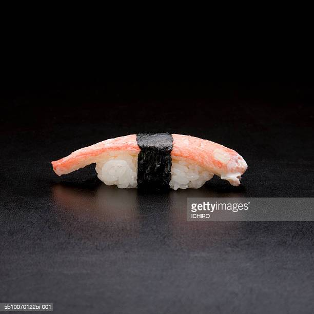 zuwaigani nigiri sushi on black background - chionoecetes opilio stock photos and pictures