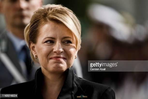 Zuzana Caputova new Slovak President arrives for a welcome ceremony by German President FrankWalter Steinmeier at Schloss Bellevue on August 21 2019...