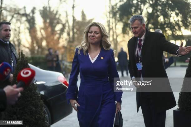 Zuzana Caputova Slovakia's president arrives for a North Atlantic Treaty Organisation Leaders' meeting at the Grove Hotel near Watford UK on...