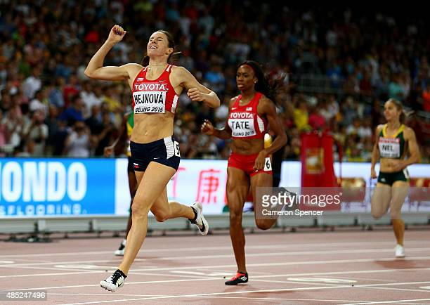 Zuzana Hejnova of the Czech Republic crosses the finish line to win gold in the Women's 400 metres hurdles final during day five of the 15th IAAF...