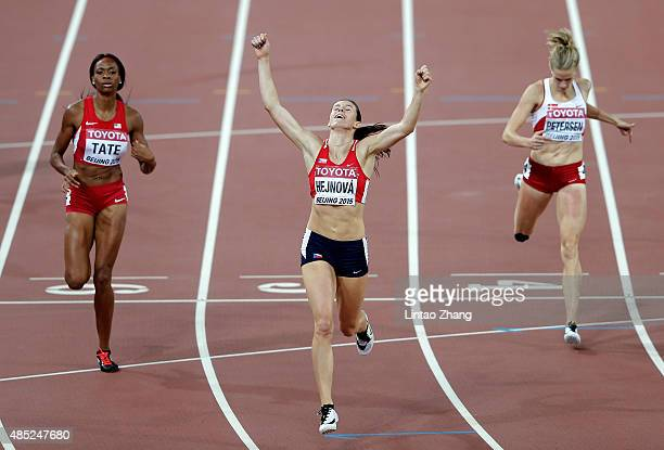Zuzana Hejnova of the Czech Republic crosses the finish line to win gold ahead of Cassandra Tate of the United States in the Women's 400 metres...