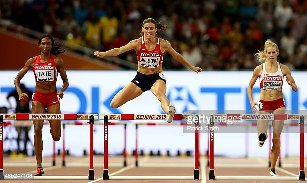 Zuzana Hejnova of the Czech Republic on her way to winning gold ahead of Cassandra Tate of the United States in the Women's 400 metres hurdles final...