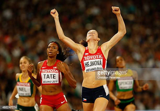 Zuzana Hejnova of the Czech Republic wins gold ahead of Cassandra Tate of the United States in the Women's 400 metres hurdles final during day five...
