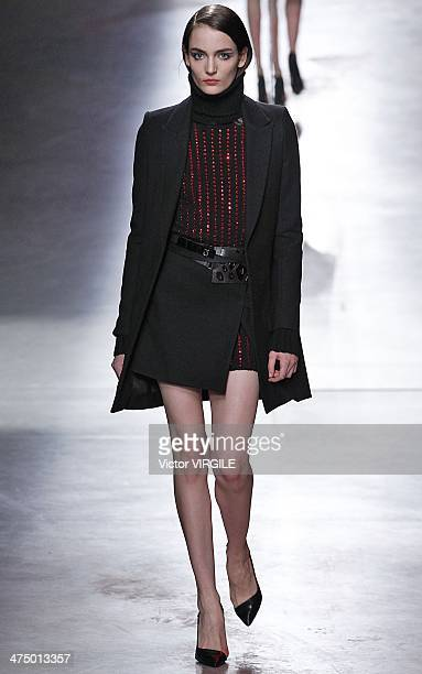 Zuzanna Bijoch walks the runway during the Anthony Vaccarello show as part of the Paris Fashion Week Womenswear Fall/Winter 2014-2015 on February 25,...