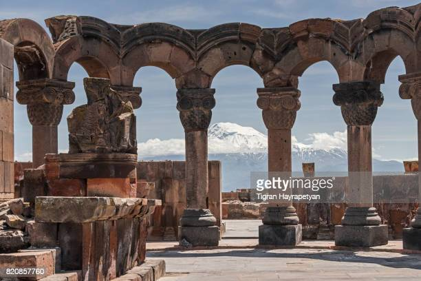 zvartnots cathedral ruins in the background of mount ararat, armenia. - armenia stock pictures, royalty-free photos & images