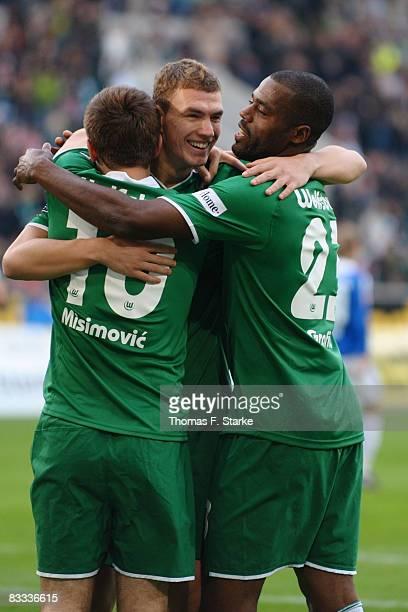 Zvjezdan Misimovic Edin Dzeko and Grafite of Wolfsburg celebrate their first goal during the Bundesliga match between VFL Wolfsburg and Arminia...