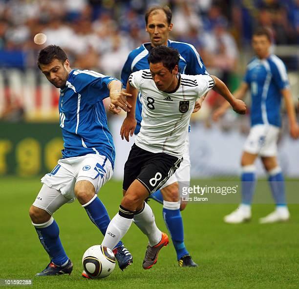 Zvjezdan Misimovic of Bosnia challenges Mesut Oezil of Germany during the international friendly match between Germany and Bosnia-Herzegovina at...