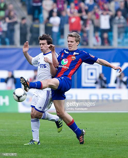 Zvjezdan Misimovic of FC Dynamo Moscow and Pontus Wernbloom of PFC CSKA Moscow vie for the ball during the Russian Football League Championship match...