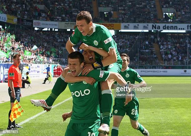 Zvjezdan Misimovic of Wolfsburg celebrates after scoring his team's first goal during the Bundesliga match between VfL Wolfsburg and Werder Bremen at...