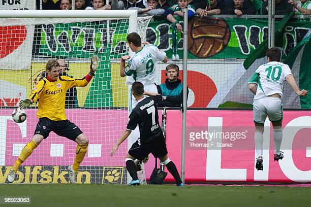 Zvjezdan Misimovic of Wolfsburg scores against Ralf Faehrmann of Frankfurt during the Bundesliga match between VfL Wolfsburg and Eintracht Frankfurt...