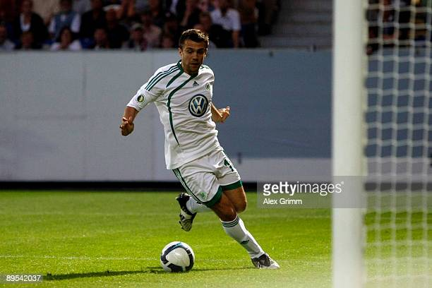 Zvjezdan Misimovic of Wolfsburg scores his team's second goal during the DFB Cup first round match between SV WehenWiesbaden and VfL Wolfsburg at the...