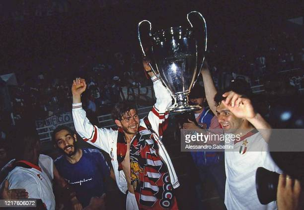 Zvonimir Boban and Dejan Savicevic of AC Milan lift the trophy after winnign the Champions League Final match between AC Milan and Barcelona at...