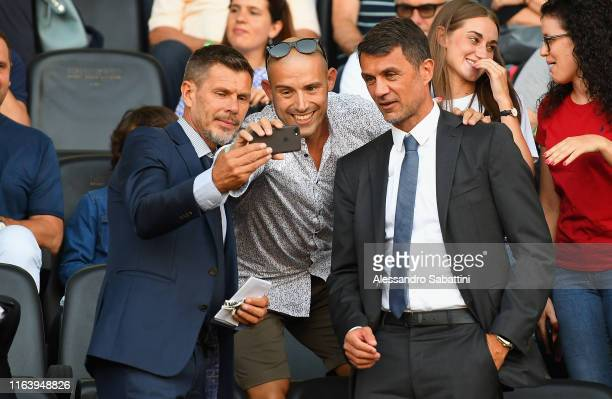 Zvonimir Boban and Paolo Maldini of AC Milan take a selfie for fans during the Serie A match between Udinese Calcio and AC Milan at Stadio Friuli on...