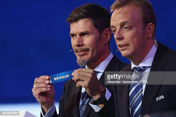 Zvonimir Boban, deputy general secretary for football holds up the name of New Zealand during the Official Draw for the FIFA Confederations Cup...
