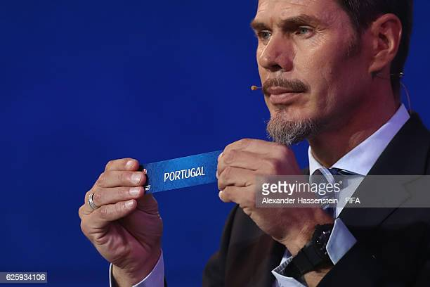 Zvonimir Boban, deputy general secretary for football holds up the name of Portugal during the Official Draw for the FIFA Confederations Cup Russia...