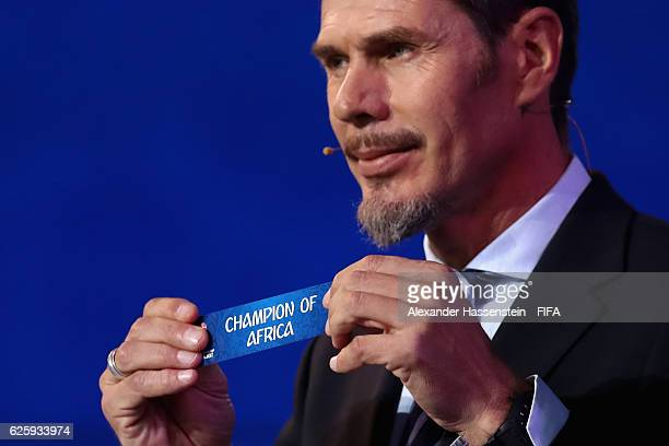 Zvonimir Boban, deputy general secretary for football holds up the sign for the Champion of Africa during the Official Draw for the FIFA...