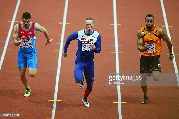 Zvonimir Ivaskovic of Croatia Richard Kilty of Great Britain Northern Ireland and Brian Mariano of Netherlands compete in the Men's 60 metres rounds...