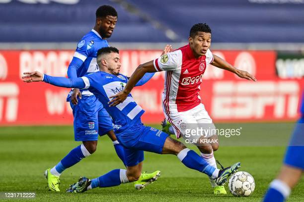 Zwolle's Dutch defender Kenneth Paal and team mate Dutch midfielder Mustafa Saymak fight for the ball against Ajax's Brazilian forward David Neres...