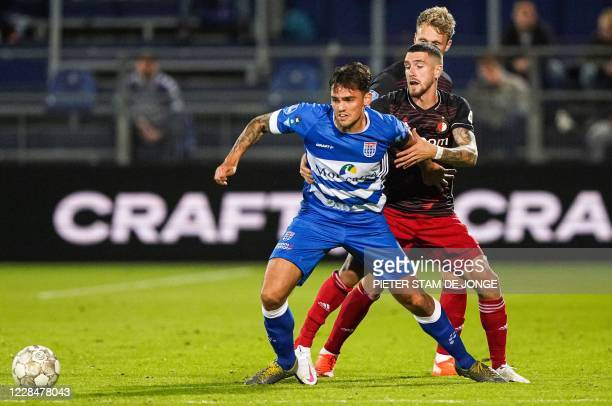 Zwolle's Dutch defender Sam Kersten and Feyenoord's Argentine defender Marcos Senesi fight for the ball during the Dutch Eredivisie match between PEC...
