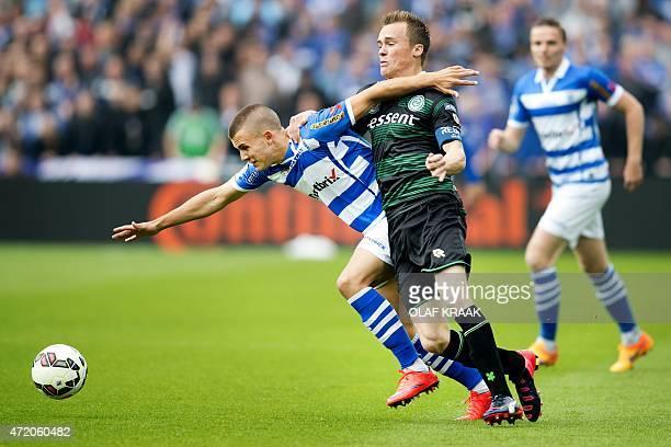 PEC Zwolle's midfielder Jespere Drost vies with FC Groningen's defender Maikel Kieftenbeld during the Dutch KNVB Cup football final match between PEC...