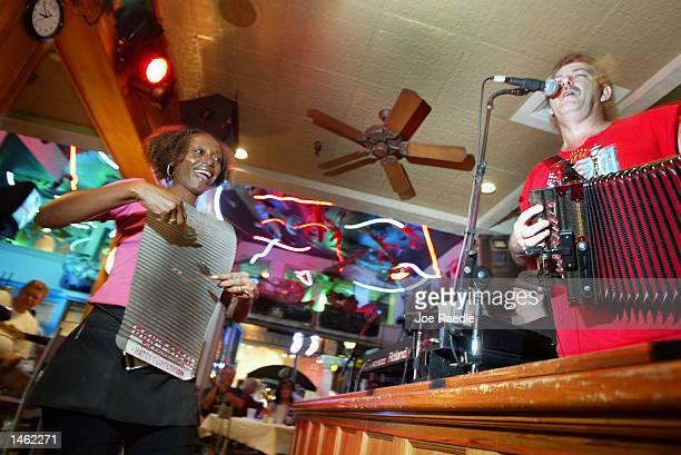 Zydeco band plays in a bar along Bourbon Street October 4, 2002 in the French Quarter of New Orleans, Louisiana. With Its exquisite Spanish...