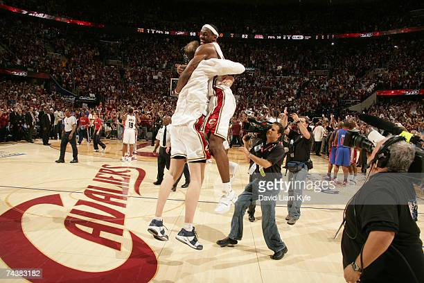 Zydrunas Ilgauskas and LeBron James of the Cleveland Cavaliers celebrate after clinching the Eastern Conference Championship with a 98 to 82 victory...