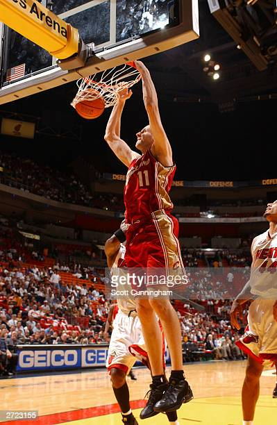 Zydrunas Ilgauskas of the Cleveland Cavaliers dunks against the Miami Heat during NBA action on November 12 2003 at American Airlines Arena in Miami...