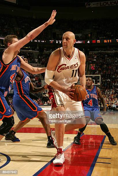 Zydrunas Ilgauskas of the Cleveland Cavaliers gets ready to go up for the shot against David Lee of the New York Knicks at The Quicken Loans Arena on...
