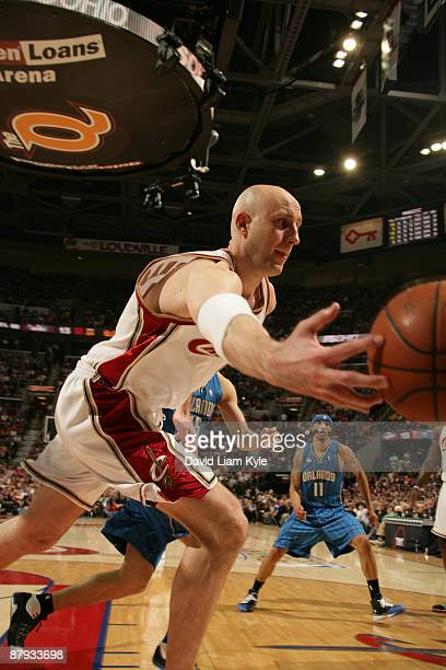 Zydrunas Ilgauskas of the Cleveland Cavaliers reaches for the loose ball in the second quarter against the Orlando Magic in Game Two of the Eastern...