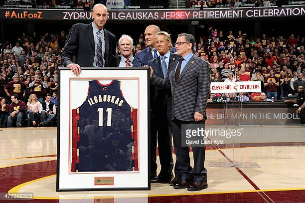 Zydrunas Ilgauskas of the Cleveland Cavaliers receives a framed jersey during halftime of the game against the New York Knicks at The Quicken Loans...