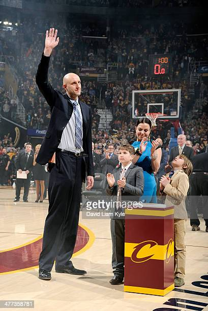 Zydrunas Ilgauskas of the Cleveland Cavaliers retires his jersey during halftime of the game against the New York Knicks at The Quicken Loans Arena...