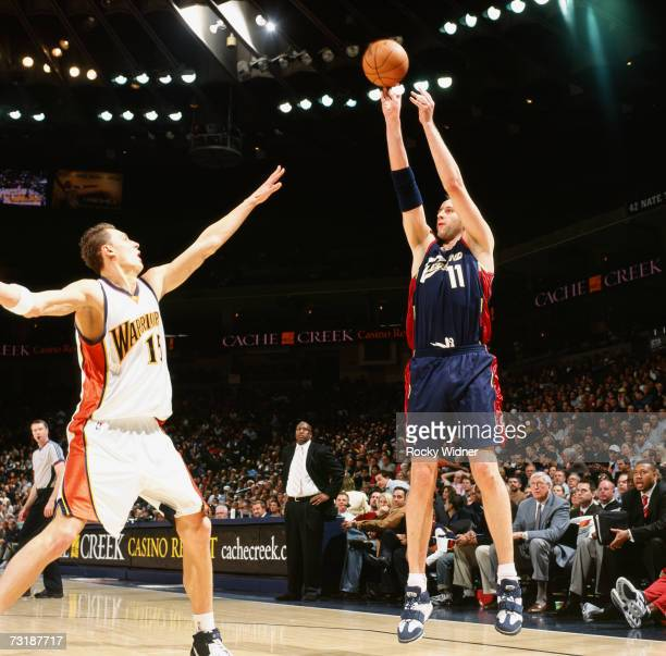 Zydrunas Ilgauskas of the Cleveland Cavaliers shoots a jump shot over Andris Biedrins of the Golden State Warriors during a game at Oracle Arena on...