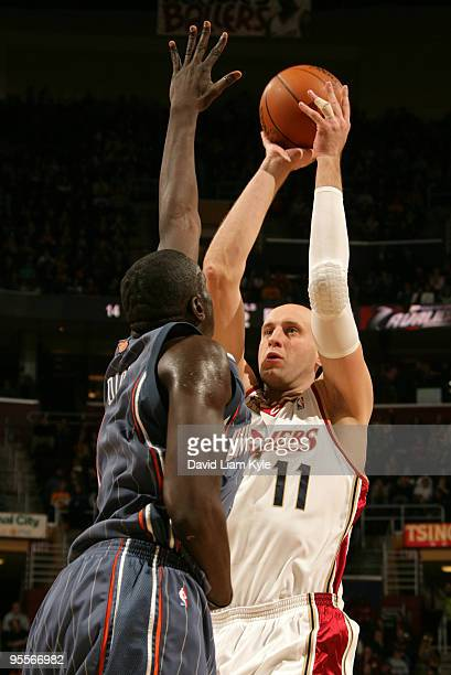 Zydrunas Ilgauskas of the Cleveland Cavaliers shoots over DeSagana Diop of the Charlotte Bobcats on January 3 2010 at The Quicken Loans Arena in...
