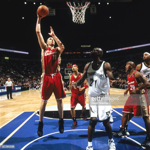 Zydrunas Ilgauskas of the Cleveland Cavaliers shoots over Kevin Garnett of the Minnesota Timberwolves during a game at Target Center on February 17...