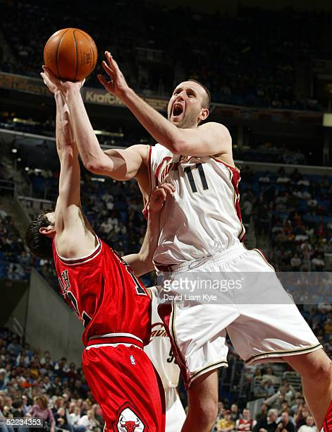 Zydrunas Ilgauskas of the Cleveland Cavaliers shoots over Kirk Hinrich of the Chicago Bulls on February 23, 2005 at Gund Arena in Cleveland, Ohio....