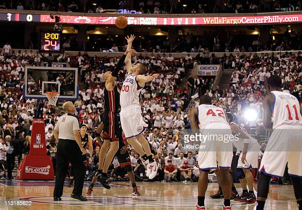 Zydrunas Ilgauskas of the Miami Heat and Spencer Hawes of the Philadelphia 76ers go up for the tip off in Game Three of the Eastern Conference...