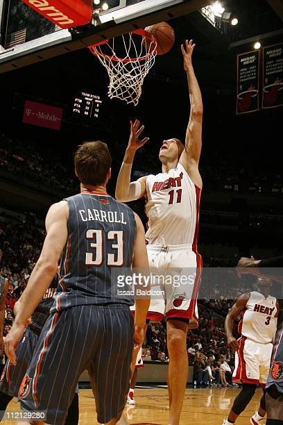 Zydrunas Ilgauskas of the Miami Heat goes to the basket against Matt Carroll of the Charlotte Bobcats during the NBA game on April 8 2011 at American...