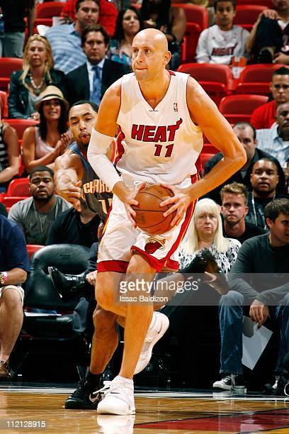 Zydrunas Ilgauskas of the Miami Heat looks to pass the ball against the Charlotte Bobcats during the NBA game on April 8 2011 at American Airlines...