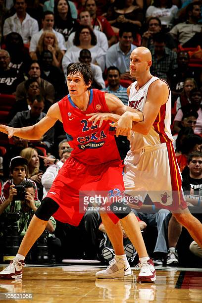 Zydrunas Ilgauskas of the Miami Heat plays defense against Boban Marjanovic of CSKA Moscow during a game on October 12 2010 at American Airlines...