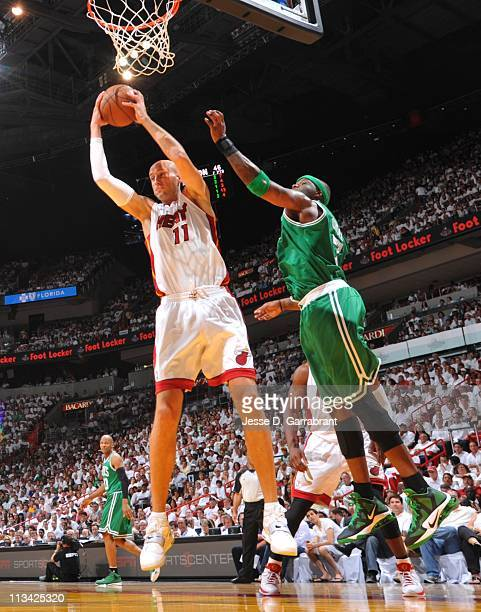 Zydrunas Ilgauskas of the Miami Heat rebounds against Jermaine O'Neal of the Boston Celtics in Game One of the Eastern Conference Semifinals during...