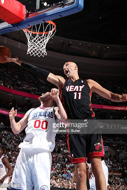 Zydrunas Ilgauskas of the Miami Heat rebounds against Spencer Hawes of the Philadelphia 76ers in Game Three of the Eastern Conference Quarterfinals...