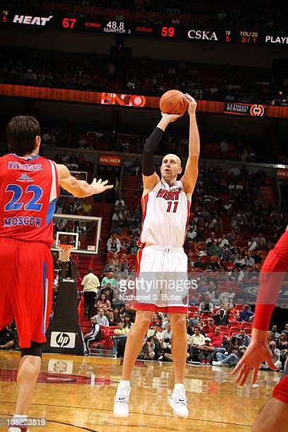 Zydrunas Ilgauskas of the Miami Heat shoots against Boban Marjanovic of CSKA Moscow during a game on October 12 2010 at American Airlines Arena in...