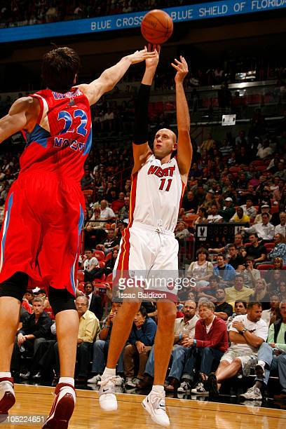 Zydrunas Ilgauskas of the Miami Heat shoots against Boban Marjanovic of the CSKA Moscow on October 12 2010 at American Airlines Arena in Miami...