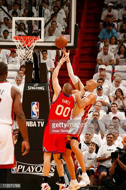 Zydrunas Ilgauskas of the Miami Heat shoots against Spencer Hawes of the Philadelphia 76ers in Game One of the Eastern Conference Quarterfinals in...
