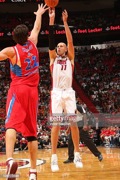 Zydrunas Ilgauskas of the Miami Heat shoots Boban Marjanovic of the CSKA Moscow on October 12 2010 at American Airlines Arena in Miami Florida NOTE...