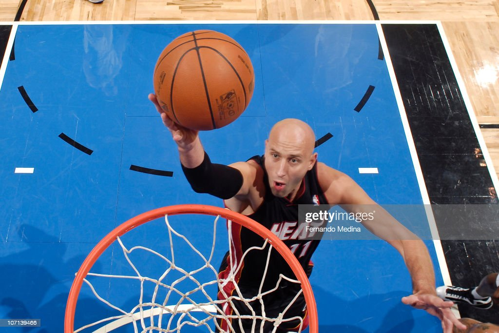 Zydrunas Ilgauskas #11 of the Miami Heat takes the ball to the basket against the Orlando Magic on November 24, 2010 at the Amway Center in Orlando, Florida.