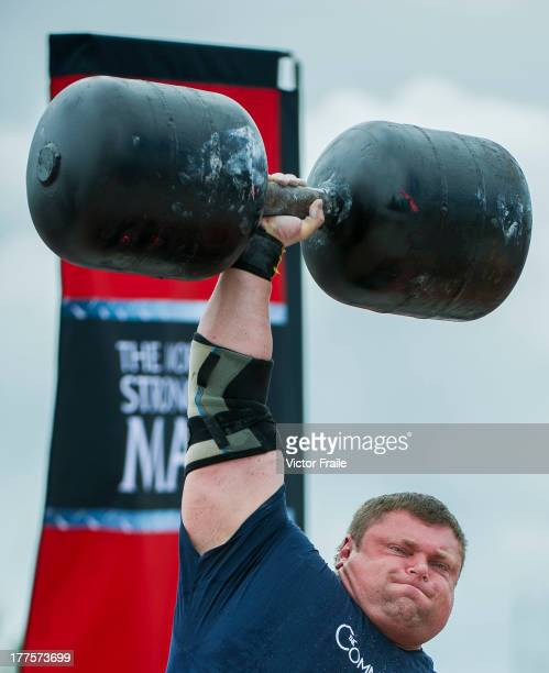 Zydrunas Savickas of Lithuania competes at the Circus Medley event during the World's Strongest Man competition at Yalong Bay Cultural Square on...